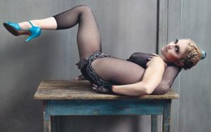 Madonna in high heels, with one leg behind her head--because why not?